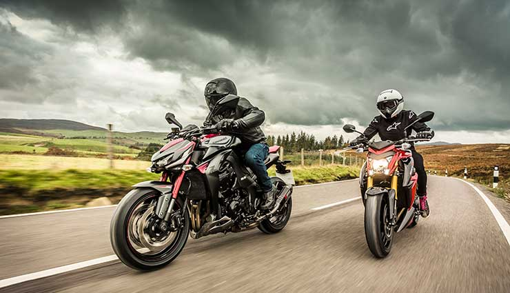 two-winter-motorcyclists-ride-under-clouds.jpg
